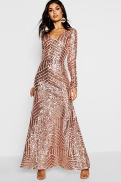 326519e2cd9f Click here to find out about the Boutique Sequin & Mesh Maxi Dress from  Boohoo