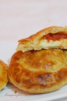 Rustici leccesi are a tasty and delicious specialties from Lecce (Apulia). It is a crisp disk of puff pastry with a filling of besciamella, tomato and mozzarella #food