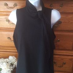 "American Living Black Sweater Tank With Tie Light sweater feel. 81% cotton and 19% nylon.  Approximately 22"" in length.  Brand new.  Can tie in a bow or just a knot.  When laid flat and measured from armpit to armpit it is 18"" across. American Living Tops Tank Tops"