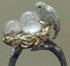 Zhaoyi Cuiwu, Colorless Cabochon Jadeite and Diamond Ring.