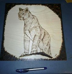 This is a woodburning of a mountain lion. It is burned on a birch panel and measures approximately 1.5 feet by 1.5 feet. Ballpoint pen shown for scale. As of this moment it is priced at an unframed price. This piece took over 18 hours to complete. I stopped keeping track :)