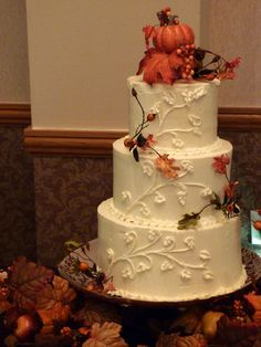 Buttercream Fall wedding cake with gum paste leaves and berries.