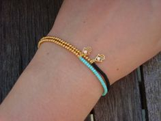 Stretchy Black and Gold Bracelet Mint Green Gold Hamsa Charm