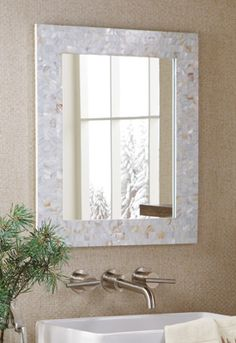 Love this mother of pearl mirror. It has so much irridescence!