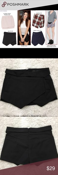 """Zara Blogger Shorts Skort !Seen on Kendall Jenner! Zara Basic mini short skort Comes with pockets and zip closure back.  Size Medium Waist laid flat 16.5"""" Rise 10"""" Seam 2"""" Approximate only.  Great condition.  No stains or holes.  Freshly washed.  Stored in a smoke and pet free household.  Please see all pictures in details or ask any questions to avoid return.  Check out my store for other items on sale! Zara Shorts Skorts"""