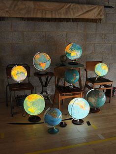 Paper transfer mapping. Globe mounted on a metal/wood base.