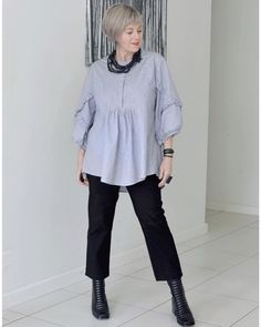Draped top worn with cropped jeans and boots | Photo shared by Deborah | For more style inspiration visit 40plusstyle.com