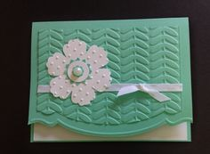 handmade notecard ... Blossoms punched flower ... textured with dots and pretty layers with a pearl at the center ... like the embossing folder and the decorative cut edge ... Stampin Up!
