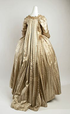 Back veiw, robe à la francaise, probably Great Britain, 1775-1780. Cream and pale salmon striped silk embroidered with floral garlands, fly fringe.