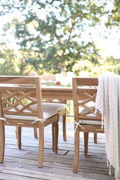 Blogger Julie Blanner's lake house deck with Ballard Designs Ceylon Teak Outdoor Furniture