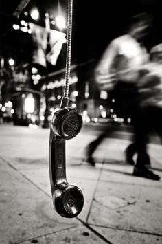 Philadelphia 471 by Michael Penn Street Photography – This is a great image because of the contrast between the dangling phone and the blurred people in the background.