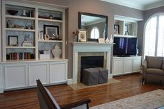 Decor the back of shelves with wall paper or fabric with color pulled from a chair or something else in room. And again mirror on fireplace