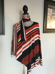 Flattering stripes in this handmade original Lucy wrap. Poncho type but with side slits,making it easy to wear under your jacket. One size fits most body types! Burnt Orange, Body Types, How To Make, How To Wear, Wraps, High Neck Dress, Stripes, Black And White, The Originals