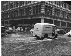 Rain pictures at 8th and Hill, 1952 :: Los Angeles Examiner Collection