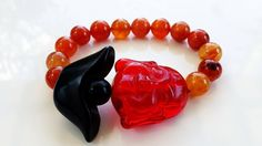 Carnelian with Tael Botswana Agate and Rubellite Buddha | Brings Wealth, Happiness and Good Luck in Business.