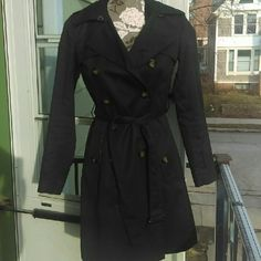 Banana Republic Spring/Fall Trench Coat Black trench coat.  Double breasted.  Excellent condition.  Not missing any buttons and comes with original belt.  She'll is 100% cotton and lining is 100% polyester. Banana Republic Jackets & Coats Trench Coats