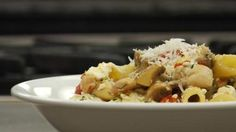 Penne pasta is tossed with chicken, feta, sun-dried tomatoes, mushrooms and a light, stock-based sauce.