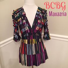 BCBGMaxAzria empire waist top 💙 I've never worn this. In excellent condition. Size says XXS, but can also fit an XS. Beautiful colors! Button detail down arm (see photo) small slits between each button, gives it an edgy look. BCBGMaxAzria Tops Blouses