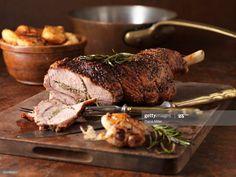 Stock Photo : Christmas dinner. Roasted rosemary and garlic leg of lamb and roast potatoes Lamb Recipes, Roast Recipes, Easter Dinner Traditional, Lamb Dinner, Dinner Menu, Dinner Ideas, Dinner Table, Feta, Slow Cooker Pork Tenderloin