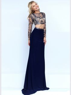 Rich and wonderful, this two piece prom dress by Sherri Hill 50097 is ready for any festive occasion. The high neckline crop bodice with chic long sleeves is made out of nude net embellished with a lavish array of glittering tonal beading. This prom stunner is bare at the midriff and will skim your shape with its form fitting jersey skirt. Two shimmering straps inject light to the open back. Features: Silhouette: Form Fitting Neckline: High Fabric: Beaded Net/Jersey Sizes Available: 00 th...
