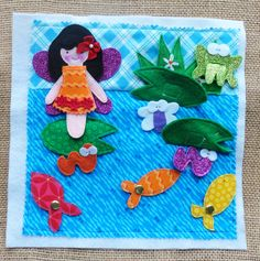 Lindy J Design spinning fish, and pockets and flaps to hide other pond critters. Cute #quiet book page for a #fairy book!