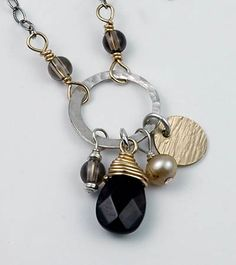 smoky quartz pendant & use of different metals together--interesting