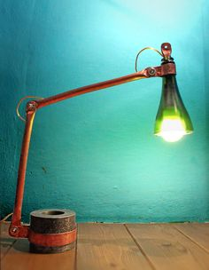 Lamp made of copper and recycled glass.