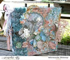 This Precious Memories Mixed Media Album by Miranda is a beautiful piece filled with gorgeous florals, feathers, and fussy cutting! #graphic45