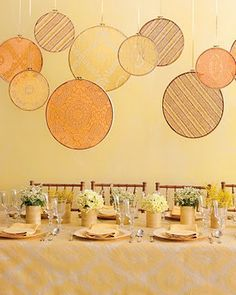 An easy and inexpensive way to add drama to your table decor is an Embroidery Hoop installation. Find out how to make your own at Martha Stewart. Martha Stewart Weddings