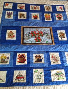 Birds and Blooms quilted using designs from emblibrary