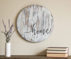 Who doesnt love old, chippy barnwood? This statement piece is sure to bring a sense of farmhouse style to your space! Expertly stained, painted, and hand distressed to create an authentic, well-worn look, this round sign is sure to become a favorite in your home. With a background