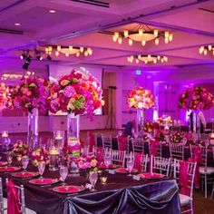 Purple wedding reception decor by Clearly Classy Events