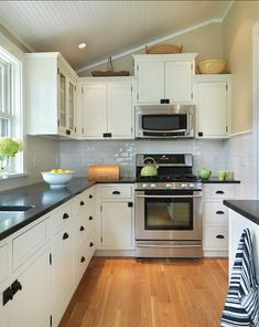 kitchen- black counter and hardware. white cabinets