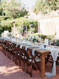 A lush, outdoor wedding in La Jolla, California with a pastel palette of dusty blue, blush and lavender juxtaposed against the sea.