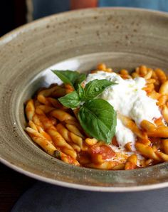GILDY PLEASURES   Fresh tomato pasta topped with burrata. All good things at Felice Wine Bar & Ristorante.