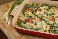 "ALEA'S TORTELLINI CASSEROLE yum!! cheese tortellini, green beans, carrots, parmesan cheese and cherry tomatoes are featured in this ""clean out the freezer"" casserole :)"