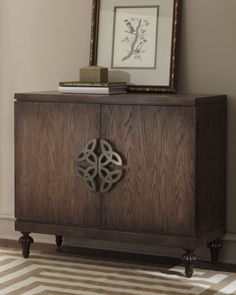 """""""Nelson"""" Chest at Horchow.  How cool to have Celtic symbols on a piece of furniture!"""