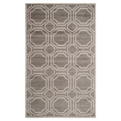 Anchor your living room seating group or define space in the den with this eye-catching rug, featuring a tile motif in olive grey.  ...