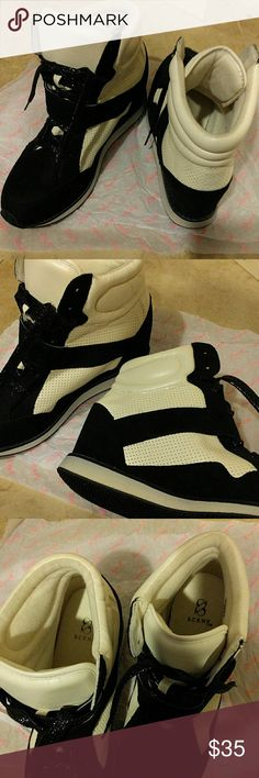 Wedged high top sneakers Brand new sneakers with low wedge heel. High top. Black and white. New without box. Very comfy! Size 8.5 Scene Shoes Wedges