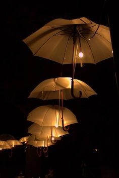 Umbrellas lighting made a beautiful feature at this French wedding