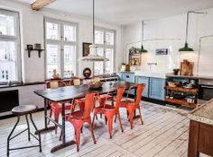 Love the wall of windows, sink and fixtures, and of course the table and chairs. I could definitely get into living in this space!