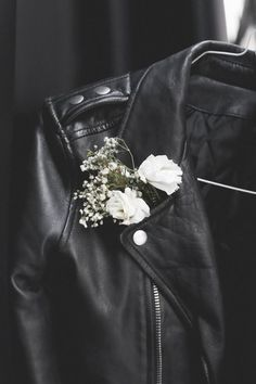 She gave one last sniff before she tucked the flower into the lapel of his leather jacket. The flower reflected the softness she knew he had that he hid behind the leather.