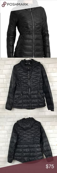 """Athleta Black Down With it Hoodie Jacket SZ Small Great Condition, Only worn 2 x , has a tiny rip next to closure zipper not really visible( See pictures) and coloring on zipper hardware is fading. Other than those small flaws it is in great condition  Nylon/Goose Down, light weight . Wind- and water-resistant . Body length 25.5"""" Shoulder-Shoulder: 16"""" Bust( Measured when zipped up) : 19"""" Two-way front zip for ventilation and enhanced mobility, hood with interior cinches for a custom fit…"""