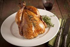 How to Cook a Whole Chicken in a Rival Eight Quart Roaster | LIVESTRONG.COM