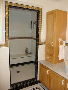 The Millard bathroom reveal:  we put tile around the shower door, aiming for an art deco flair.