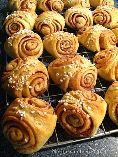 """Finnish cinnamon rolls (korvapuustit) - """"slapped ears"""" - The outside typically has a shiny brown glaze, formed by a coating of egg white, milk or a mixture of sugar and brewed coffee."""