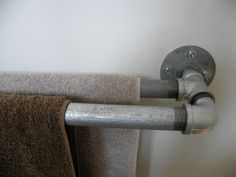 """Pinterest diy industrial towel rail! Nailed it! Even made a double rail (thanks to friends inspiration). FYI the round bit that's rawl bolted to the wall is called a """"flange""""."""