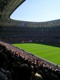 Bayern Munich's Allianz Arena bathed in sunlight.
