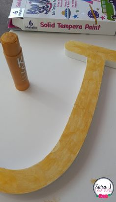 Painted wooden letter with Kwik Stix Metalix - Shimmery Fun!
