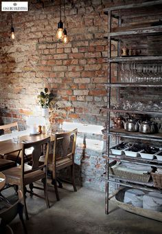 Usually the living room interior of the exposed brick wall is rustic, elegant, and casual. Exposed brick wall will affect the overall look of your house more appreciably. Industrial Interior Design, Vintage Industrial Decor, Industrial Dining, Cafe Interior Design, Industrial House, Industrial Interiors, Industrial Shelving, Vintage Decor, Industrial Style
